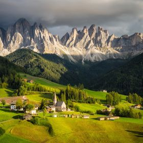 Afternoon light settles on a verdant valley in the Dolomites.