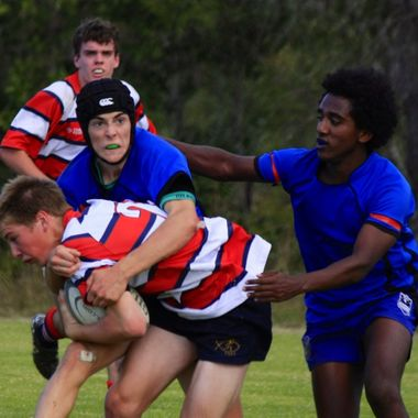 Determined to make the tackle when Nowra Christian School played Nowra Anglican College in rugby.