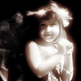 Stylised monochrome Image of a young girl wearing a fairy costume.
