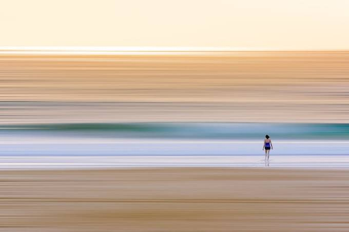 Lone Swimmer Entering Surf at Dawn_P by Toptruck - Show Minimalism Photo Contest