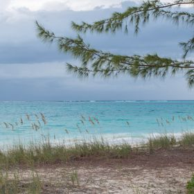 Colorful image of the beach along Grace Bay in Turks and Caicos, taken just after sunrise.