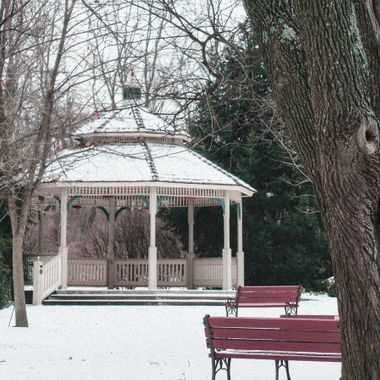 This gazebo has a forlorn and lonely look as if it is waiting for spring and a concert.