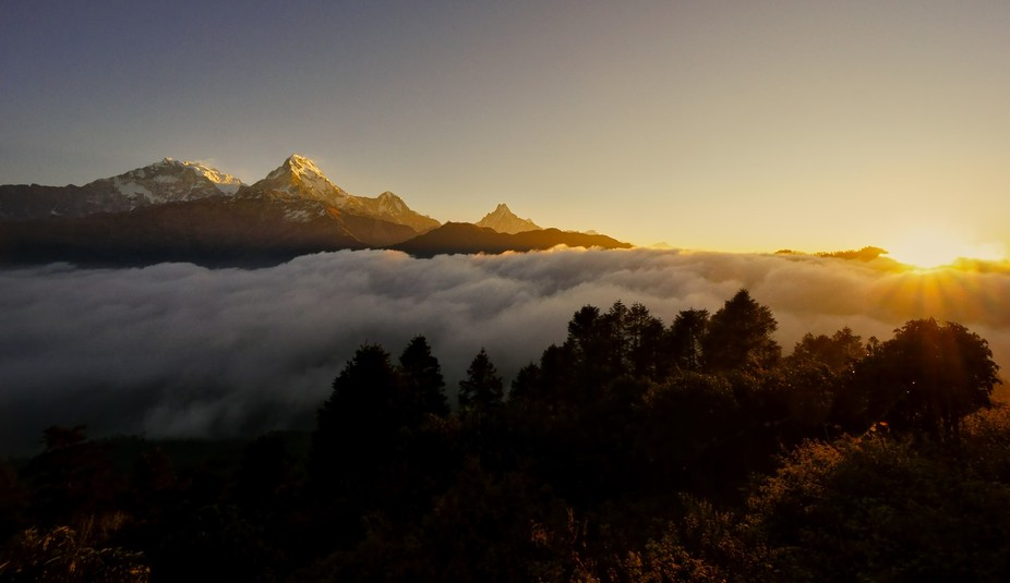 A beautiful sunrise at Annapurna I, Annapurna South and Mount Fishtail. Viewed from Poon Hill