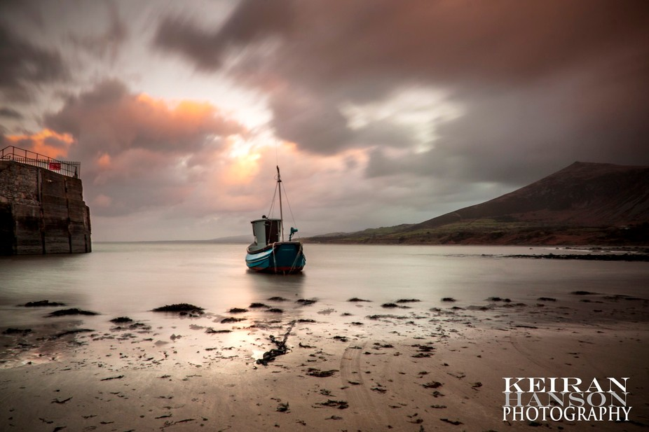 Taken during sunset at Trefor Pier North Wales. Messy business trudging wet sand. Had to leave th...