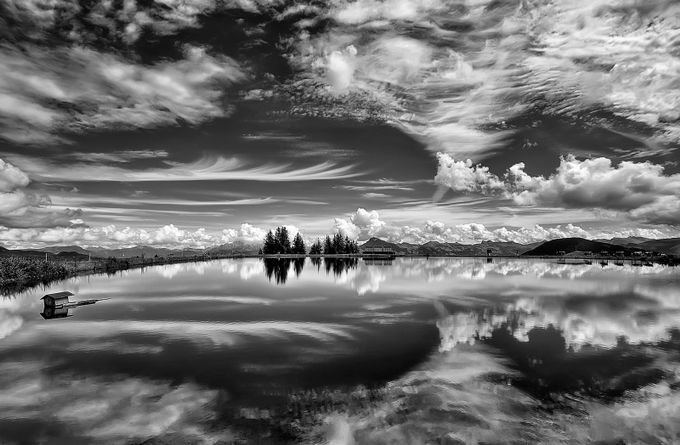 Mirror of the sky by aidagri - A Black And White World Photo Contest