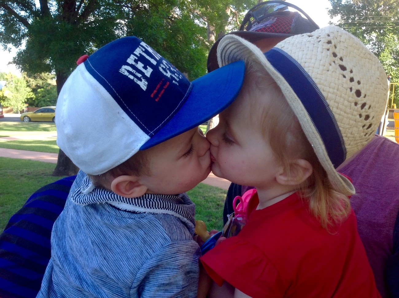 Cousins just saying goodbye after Christmas Day in the park. So cute!