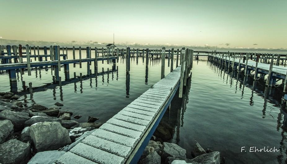 A gloomy winter evening along the shores of Lake Huron. Port Sanilac, Michigan.