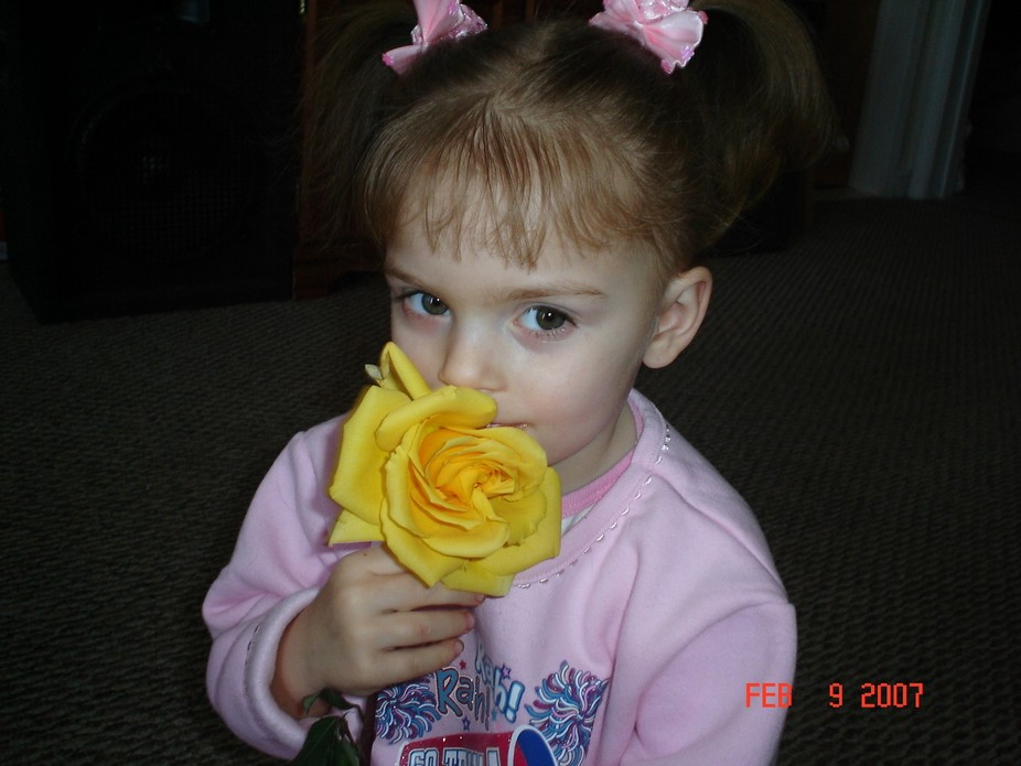Kaitlyn 4yrs. old holding one of Mom's Valentine Roses