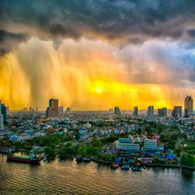 Thunderstorms moving over Bangkok towards sunset. Photographed from our hotel room balcony. Taken with a D800.