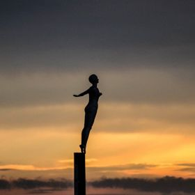 The statue is at the entrance of Scarborough harbour, North Yorkshire UK . Taken at sunrise