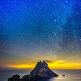 A shot of Es Vedrà, Ibiza , by night with the view to the galaxy on the back
