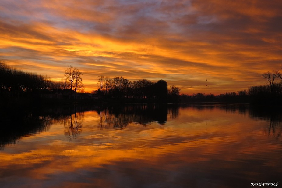 TAKEN ON THE RIVER TARN IN MOISSAC FRANCE EARLY MORNING STRAIGHT OUT OF THE CAMERA