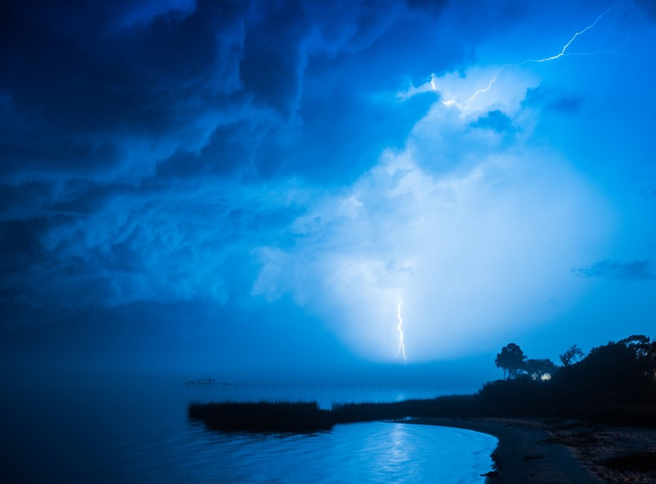 Awakened by the distant sound of thunder at 4am, I headed out to our neighborhood pier to shoot, ...