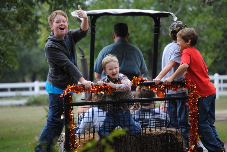 Four generations gathered at the great-grandparent's farm to celebrate the harvest season