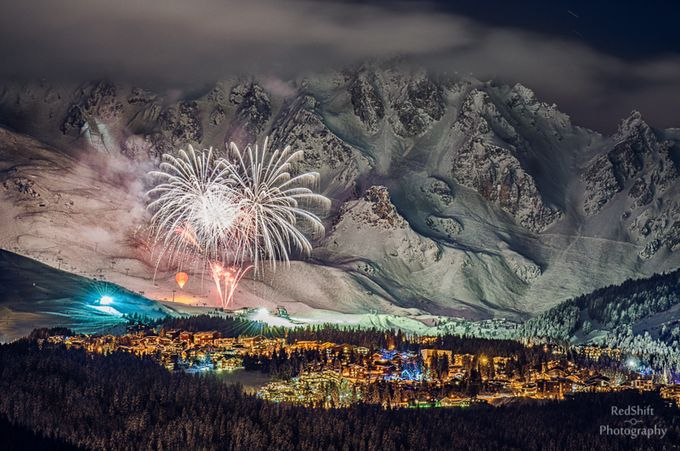 Fireworks on snow by redshiftimages - Our World At Night Photo Contest