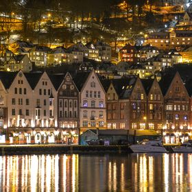 The hanseatic wharves of Bergen harbour by night, Bergen, Norway, December 2015