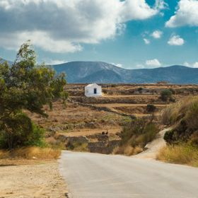 Gorgeous landscape on the island of Naxos in Greece, in the Cyclades Islands. Pretty white churches dot the hillsides throughout the island and t...