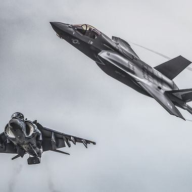 The AV-8B Harrier (lower left) has provided the United States Marine Corps with a vertical/short take off capability for decades.  The F-35B Lightning II is the next step in improving that capability.
