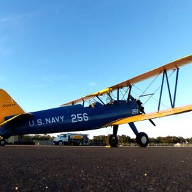 I captured this photographic image of Preston Aviation's Boeing Stearman in early January of 2015 while laying on my stomach and sliding the...