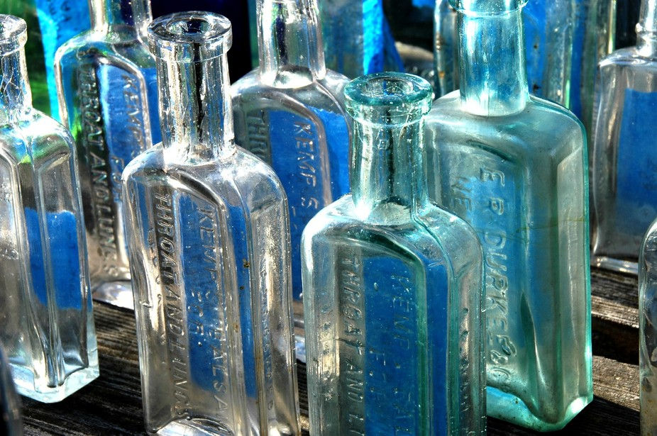 Early morning with sun low in the sky a table of vintage bottles caught my eye. This is a straigh...