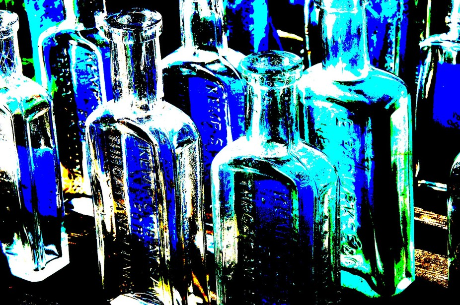 Early morning with sun low in the sky a table of vintage bottles caught my eye. This is a manipul...