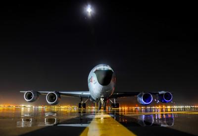 KC-135R rests on the Flightline underneath the moonlight.