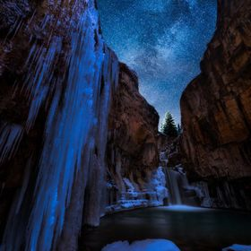 Colorado's Lime Creek Falls encased in frozen majesty beneath a blanket of stars. A blend of several exposures.