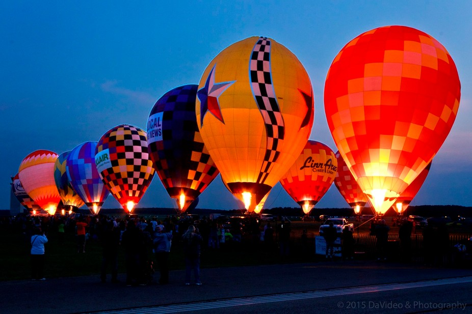 Balloonists in Battle Creek, MI simultaneously light up their grounded balloons to create a &...