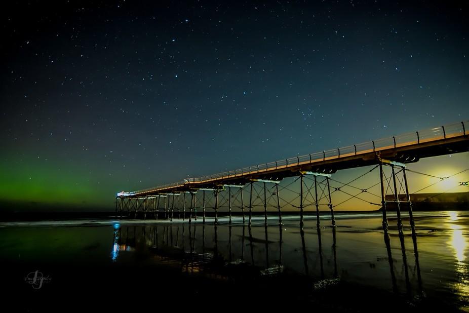Aurora and moon light at Saltburn Uk