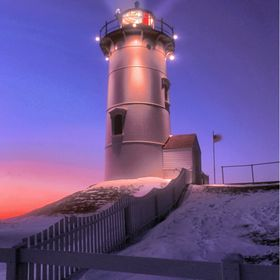 This Cape Cod lighthouse, Nobska Point Light, is located in Wood's Hole area of Falmouth (that's where the ferry goes over to Martha's  Vin...