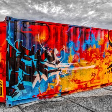 A graffiti art decorated shipping container at Le Havre port.