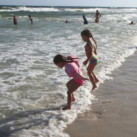 Little cousins playing in the surf