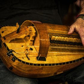 The hurdy-gurdy or viella a roue (wheeled violin) is a stringed instrument where the strings are vibrated by means of a wheel coated in rosin wh...