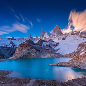 Mountains of Patagonia in Argentina lit by setting moon and rising sun