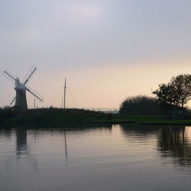Sunset at Thurne Mill in Norfolk UK.