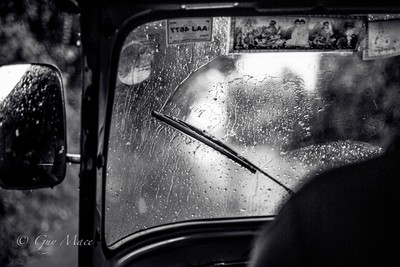 tuk tuk in the rain