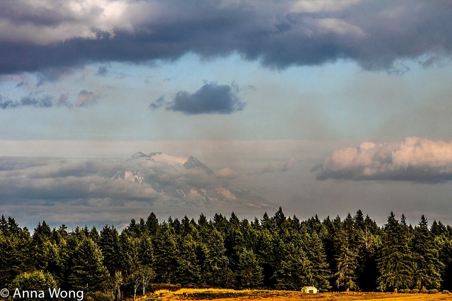 Mt Rainier amid the clouds and smoke. Initially I wasn't sure this photo turned out at a...