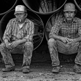 While photographing on the Gulf, I made a photograph of these 2 pipeliners taking a break. Tri-pod mounted Pentax 67, 120 Tri-X film processed n+...