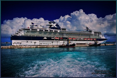 Celebrity Summit at Dockyard with wake from St. Georges Ferry Bermuda 6-1-2011.