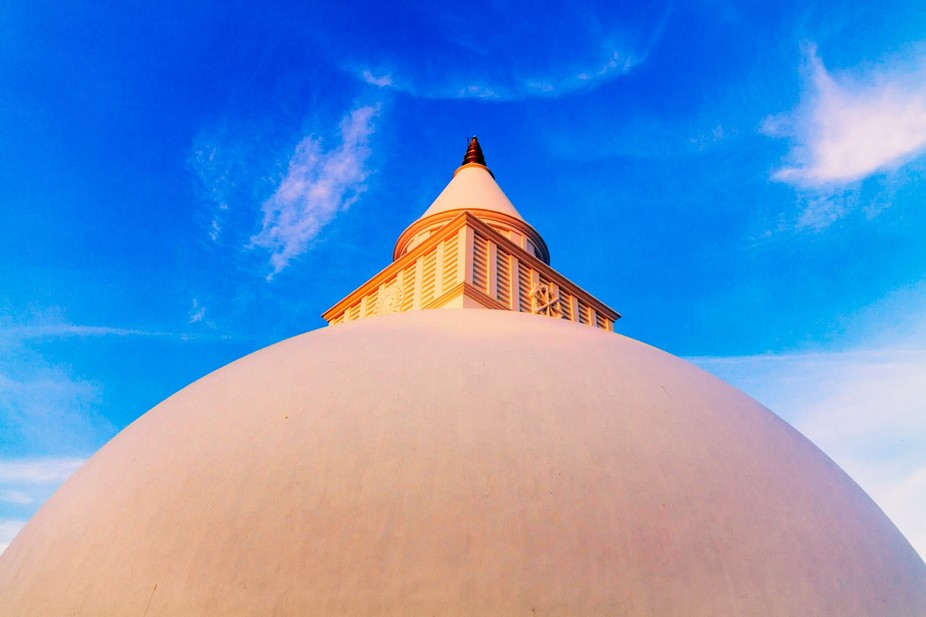 This Stupa was at Kalutara a very holy sight in Sri Lanka. love the way the sun hits it.