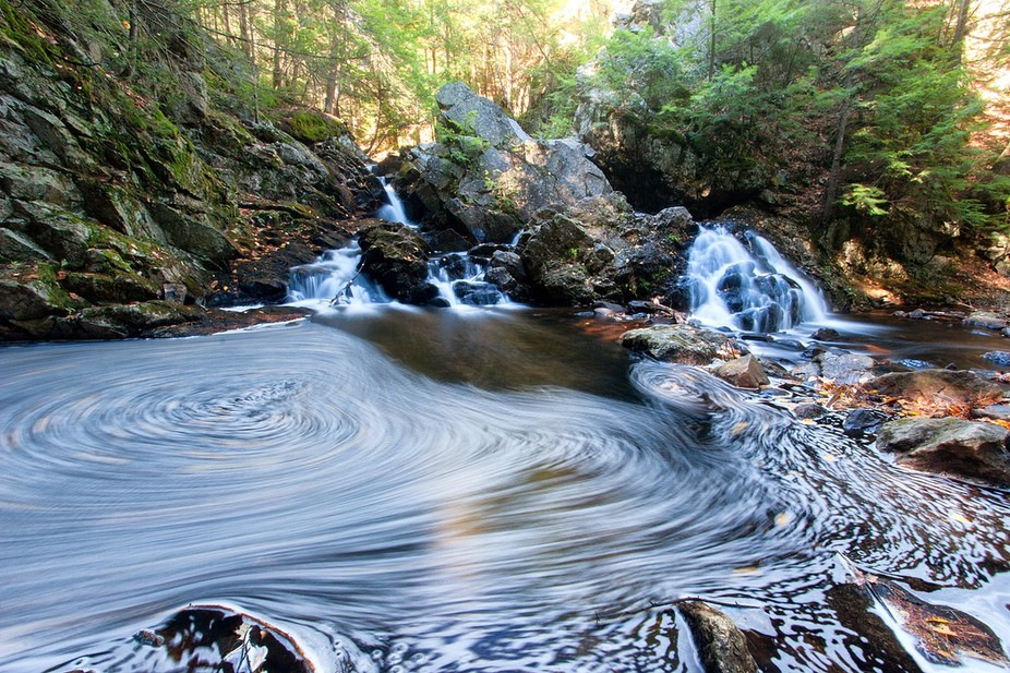 Taken at a ravine in Massachusetts.  I set up my tripod for a long exposure to capture the runnin...