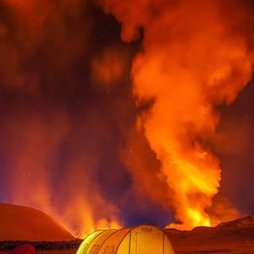 Our camp near the erupting volcano in Kamchatka. Freezing cold of -35 C and the red light was not the most problem. Every 30 seconds volcano erup...