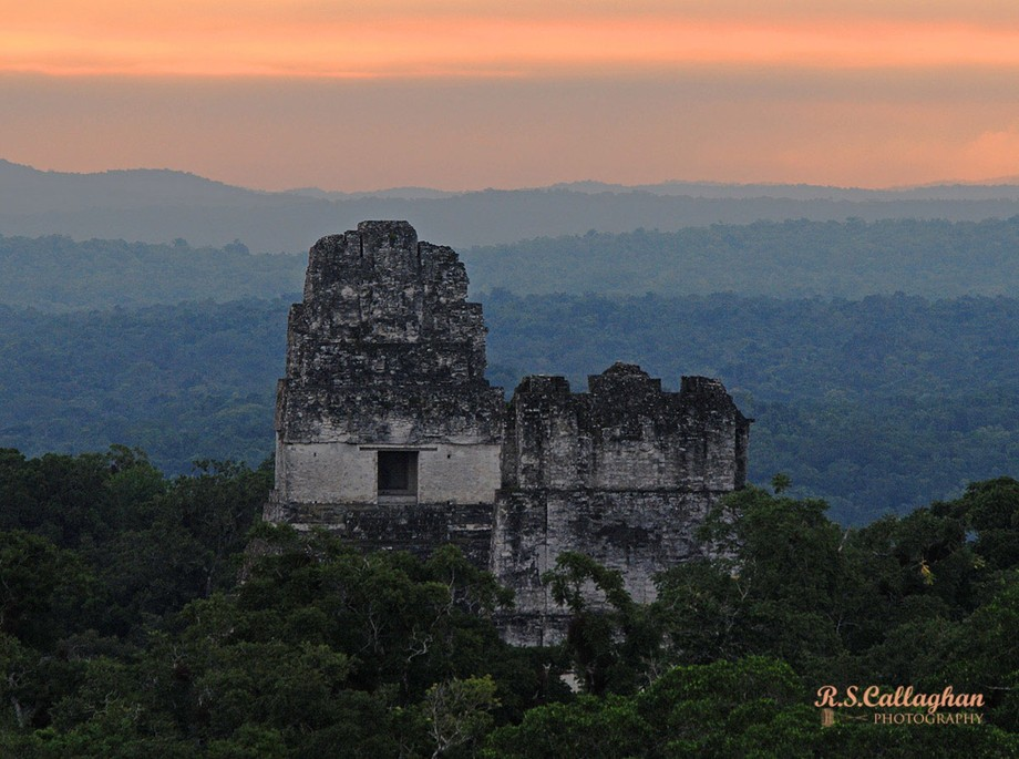 Temples I and II protrude through the Guatemalan jungle at Tikal. Along with Chichen Itza and Palenque in Mexico, Tikal was one of the major city-states of ancient Mesoamerica.
