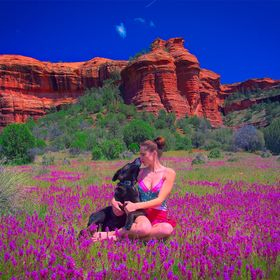 My  friend Tatyana with my dog Nisha in front of the Red Cliffs of Sedona, Arizona, USA in the summertime. Nisha spontaneously gave Tatyana a lov...
