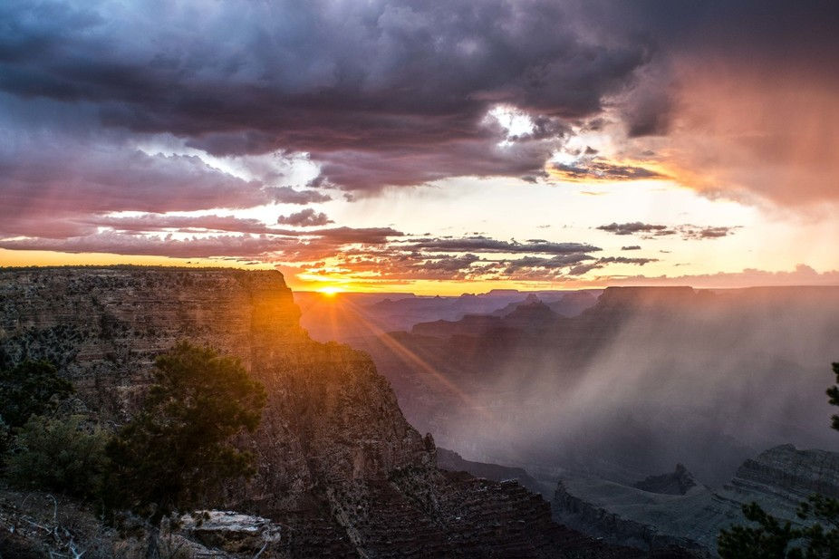 Taken at the Grand Canyon as it the sun set and it was raining in the canyon