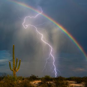 Finally! After years of trying I finally got my lightning and rainbow picture. What an awesome evening. I headed out late afternoon, shot a littl...