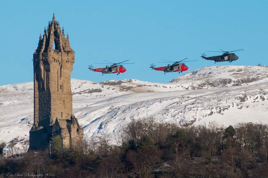 The Royal Navy's HMS Gannet fly behind The National Wallace Monument, Stirling, Scotland...