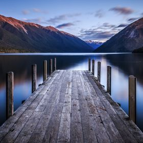Full Moon reflecting on a Pier at the shore of Lake Rotoiti, New Zealand