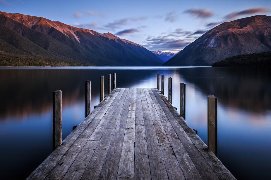 Full Moon reflecting on a Pier at the shore of Lake Rotoiti, New Zealand