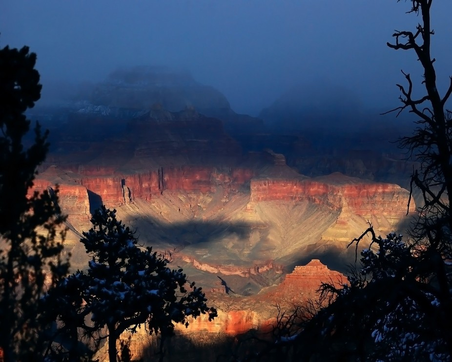 Clouds begin to settle into the Grand Canyon as the sun begins to set.